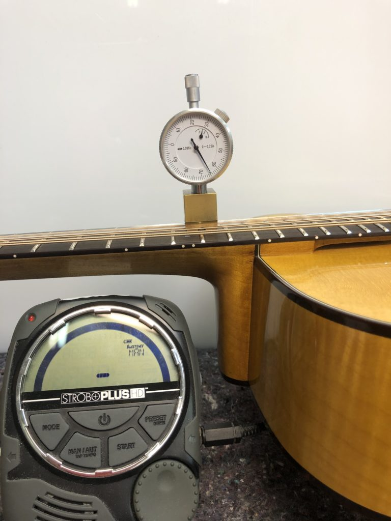 Professional String Height Tuning In Progress action How High Should Your Action Be? action height two 768x1024